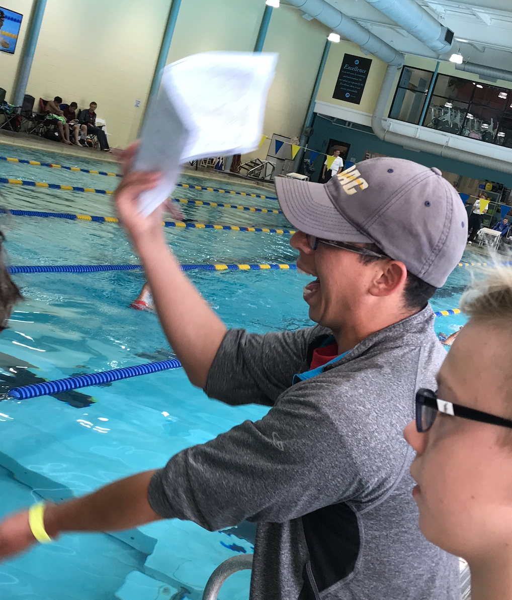 Coach Solomon cheers on swimmers at the NBAC Long Course Championships