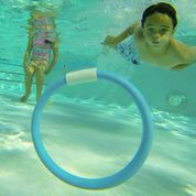 Child playing with ring under water
